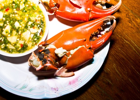 Eat crabs, seafood steam. With spicy sauce.