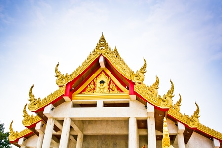 Details on Thai temple roof and sky.