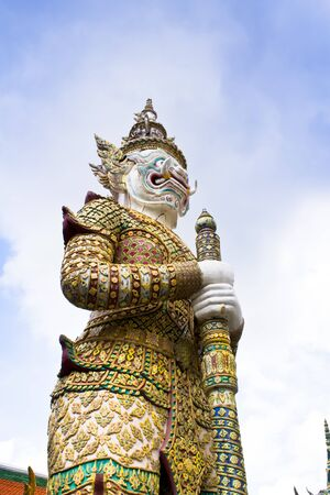 Ancient giant sculpture of The Emerald Buddha temple in Bangkok, Thailand