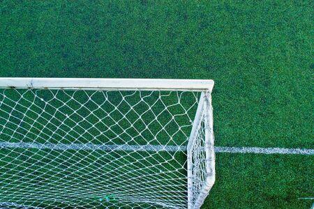 Rear corner of the football field.