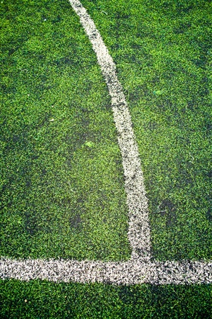 intersection of white line on soccer football field.