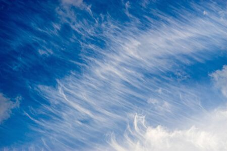 cirrus: Sky with unusual pattern of spindrift clouds. Diagonal background