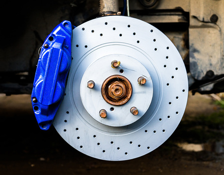 Blue brake caliper with perforated disk