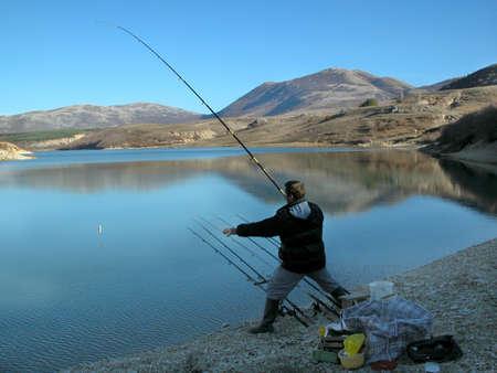 fishhook: Fisherman in action