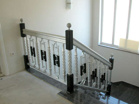 banisters: Hand rail for interiors Stock Photo