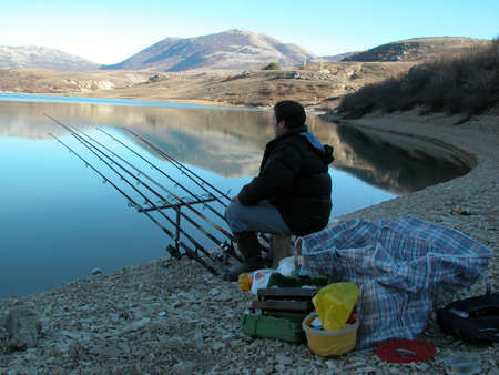 Fisherman sitting and waiting photo