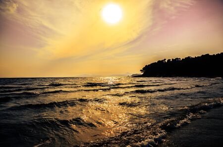 French Riviera: Sunset on the beach at Bormes les mimosas, Var, France