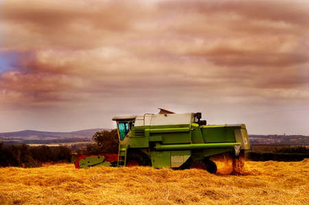 Combine harvester cutting in a field of hay. Stock Photo - 3708588