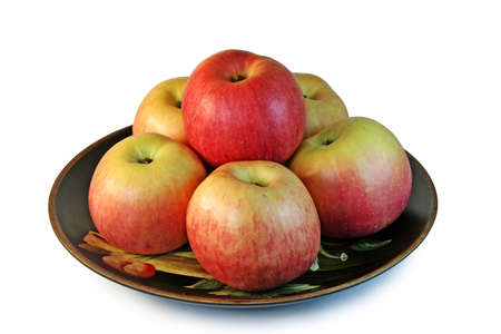 Six beautiful apples on the ceramic plate, isolated on a white background ( with clipping path ). photo