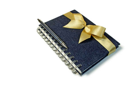 Gift set including a notebook and the pen, isolated on a white background. photo