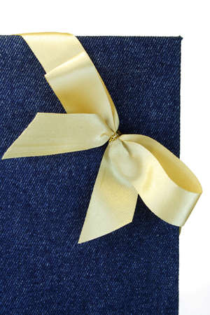 Gold bow on a jeans cover of a notebook. photo