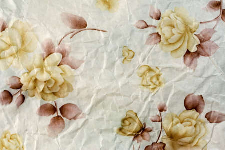 fleck: Flor de papel de fondo de un viejo papel marr�n.  Foto de archivo