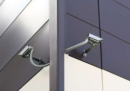 Two CCTV Security Cameras at a corner of office building.