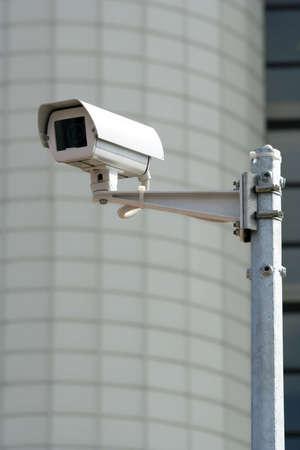 CCTV security camera  before a municipal building. Stock Photo