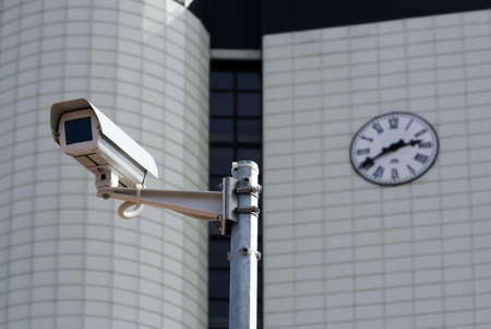 CCTV security camera  before a municipal building. Stock Photo