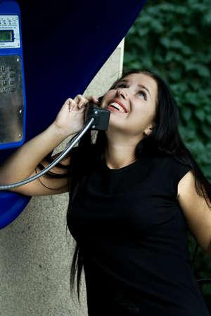 joyfully: The happy girl joyfully speaks by phone. Stock Photo