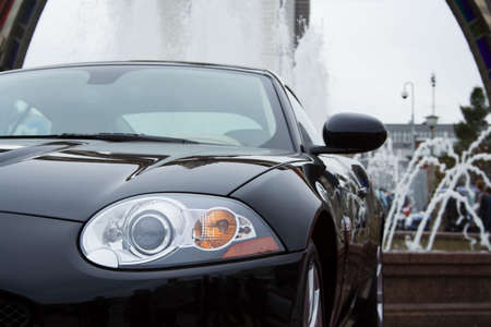 The modern sports car at a fountain. Stock Photo - 2374768