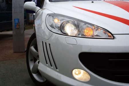 Shining headlights of the sports car. Stock Photo - 2374769