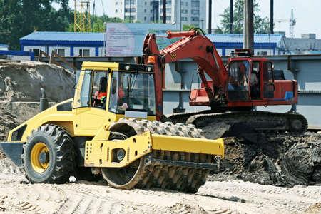 steam roller: Steam roller and excavator.