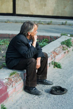 Homeless elderly beggar. Stock Photo - 2526504