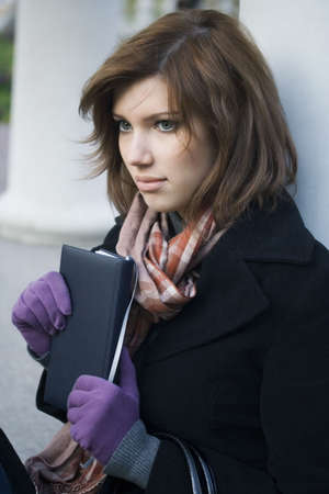 Beautiful girl holding a book. Stock Photo - 3933170