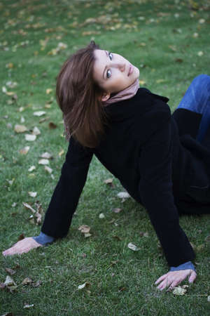 Beautiful girl relaxs on an autumn lawn. Stock Photo - 3953466