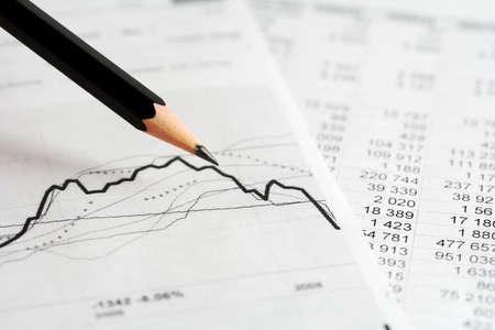 future earnings: Stock exchange graphs analysis. Stock Photo