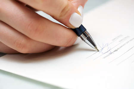 Businesswoman filling out contract. Stock Photo - 4291035