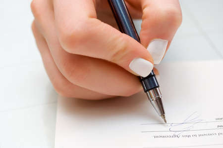 Businesswoman filling out contract. Stock Photo - 4448912