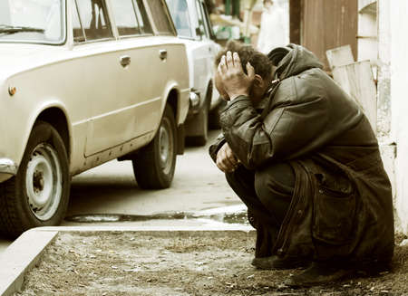 The big problems of the homeless beggar. Stock Photo