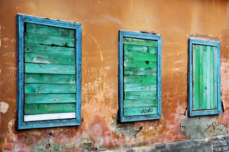Three boarded up windows of an old rundown building. Stock Photo - 4841856