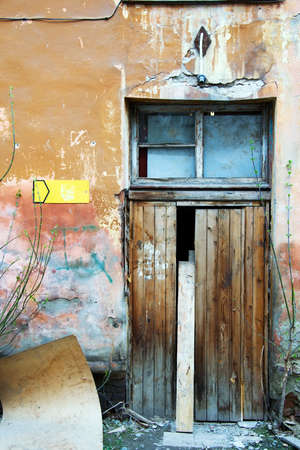 Doorway of an old rundown building. photo