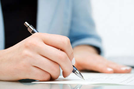 Businesswoman signing contract. Stock Photo