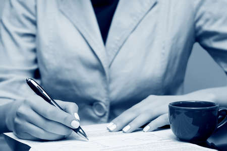 Businesswoman signing contract. Stock Photo - 4870043