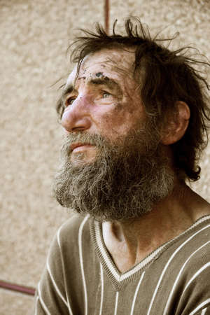 dirty old man: Despair of the poor homeless. Stock Photo