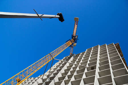 Crane on the costruction of habitable house. Stock Photo - 4917706