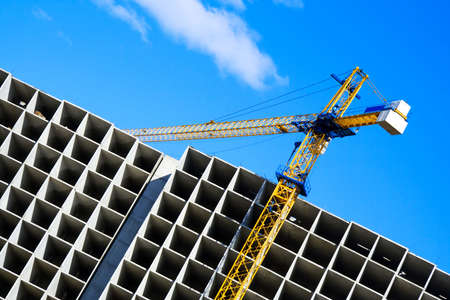 costruction: Crane on the costruction. Stock Photo