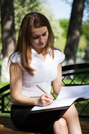 Young businesswoman working with financial reports. Stock Photo - 5035082