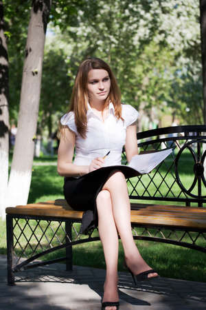 Young businesswoman working with financial reports. Stock Photo - 5063738
