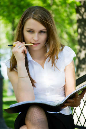 Young businesswoman working with financial reports in the park. Stock Photo - 5063748