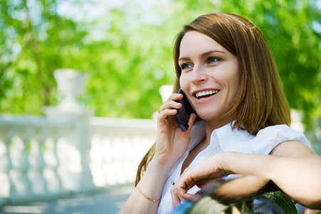 Young woman talking on the mobile phone. Stock Photo - 5063753