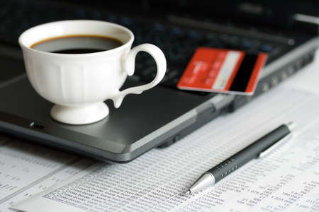 Cup of coffee and financial accounting. photo