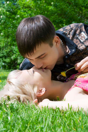 Happy young couple kissing on nature. photo