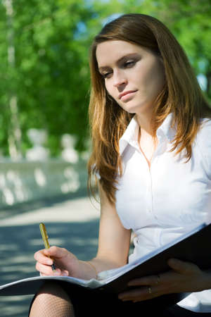 Young businesswoman working with financial reports. Stock Photo - 5112558