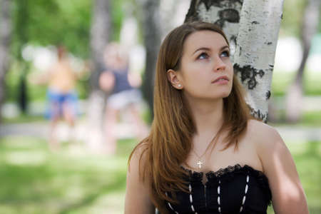 Thoughtful young woman looking away. Stock Photo - 5303398
