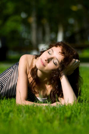 Young beautiful woman relaxing on the grass. Stock Photo - 5343715