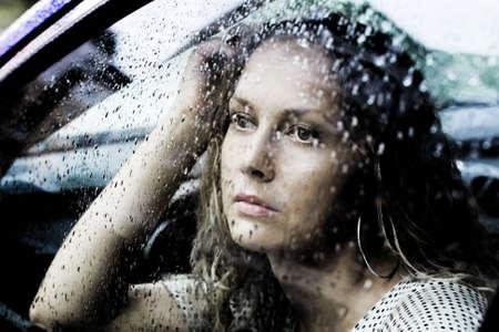 Sad young woman and rain. photo