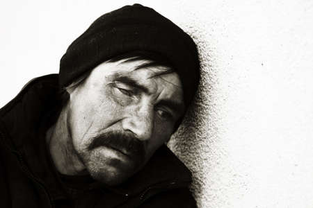 Homeless man on a city street. photo