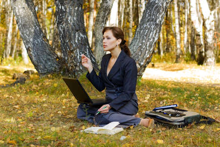 Young businesswoman working on nature. Stock Photo - 5679831