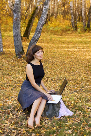 Young businesswoman using laptop on nature. Stock Photo - 5745191